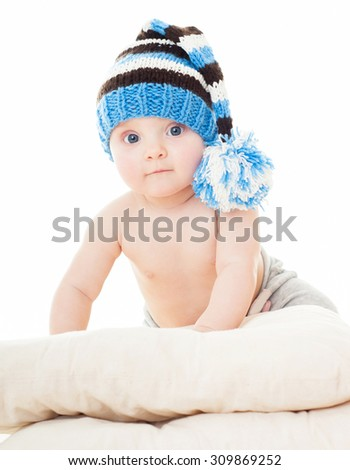 cheerful baby in the blue hat. Beautiful happy baby . One,isolated on white.