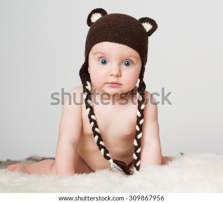 cheerful baby in the hat. Beautiful happy baby. - stock photo