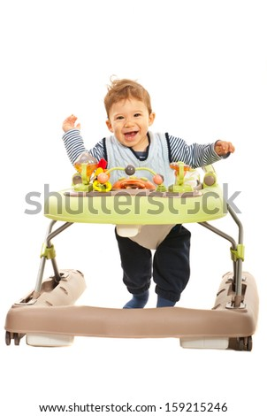 Cheerful baby running in a walker isolated on white background