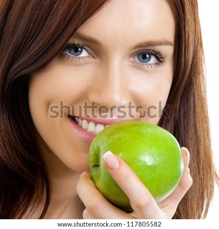 Cheerful beautiful woman eating apple, isolated over white background - stock photo