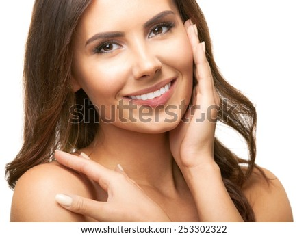 Cheerful beautiful young woman touching skin or applying cream, isolated against white background
