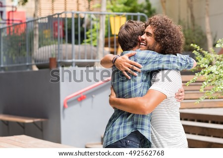 Cheerful Best Friends Embracing Each Other Stock Photo ...