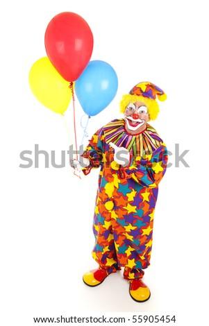 Cheerful birthday clown holding balloons.  Full body isolated on white. - stock photo