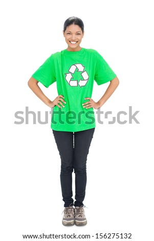 Cheerful black haired model wearing recycling tshirt on white background - stock photo