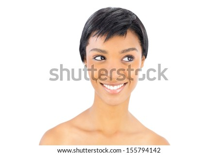 Cheerful black haired woman posing looking away on white background - stock photo