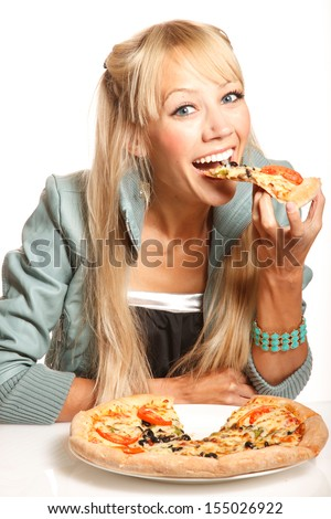 Cheerful blond fashion woman eats pizza on white background