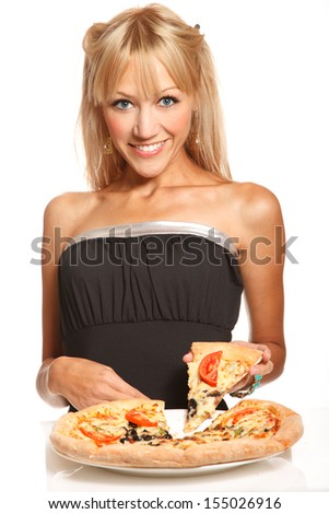 Cheerful blond fashion woman takes one peace of pizza on white background