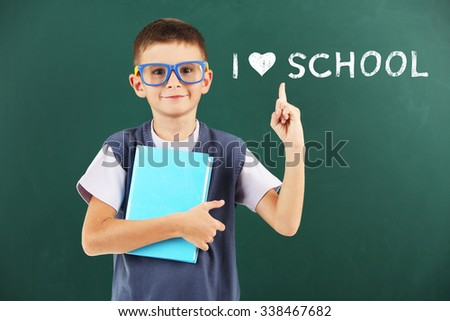 Cheerful boy at the blackboard. I love learning concept - stock photo