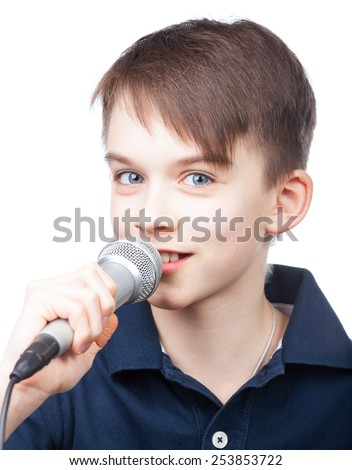 Cheerful boy holding microphone singing or speaking on white background - stock photo