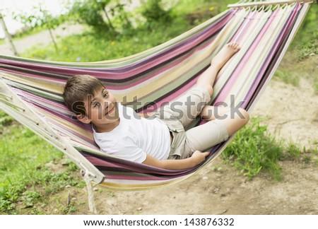 Boy hammock on nature stock photo 145777586 shutterstock for Cheerful nature