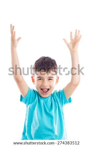Cheerful boy raised his hands up with joy - stock photo
