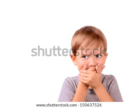 cheerful boy 5 years shut by the hands mouth. Horizontal Image isolated on white background - stock photo