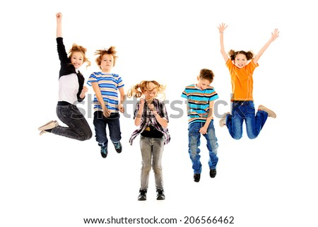 Cheerful boys and girls jumping for joy. Happiness. Isolated over white. - stock photo
