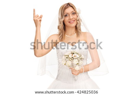 Cheerful bride in a white wedding dress pointing up with her finger isolated on white background - stock photo