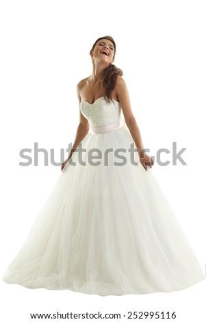Cheerful bride posing in fashionable wedding dress - stock photo