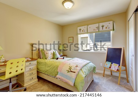 Cheerful bright kids room with chalkboard and desk - stock photo