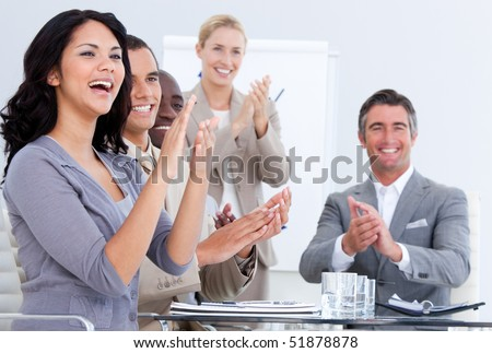 Cheerful business people applauding in a meeting. Business concept. - stock photo