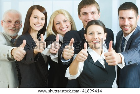 Cheerful business people showing that everything is OK - stock photo