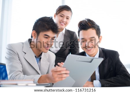 Cheerful business team discussing new financial plan