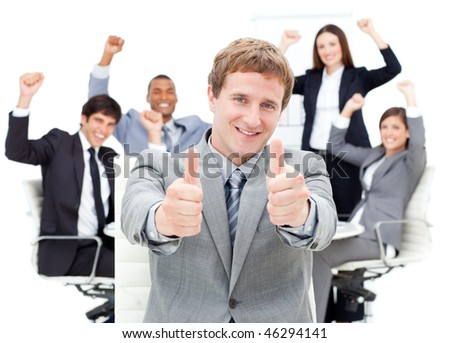Cheerful business team punching the air in a meeting - stock photo