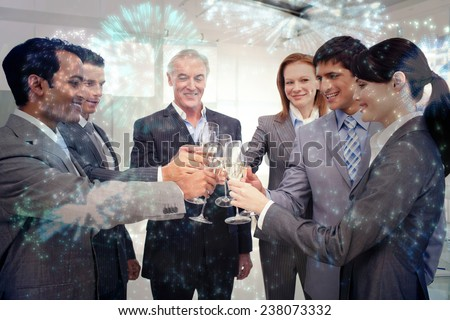 Cheerful business team toasting with Champagne against colourful fireworks exploding on black background - stock photo