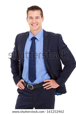 cheerful businessman hands on hip and looking at the camera - stock photo
