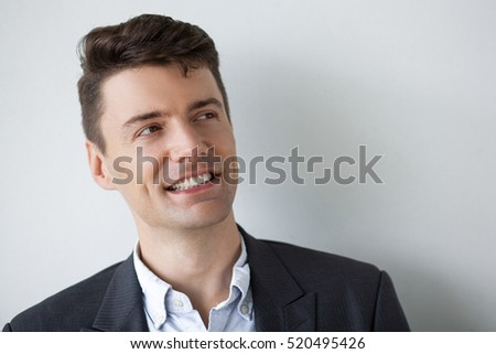 Cheerful businessman looking aside