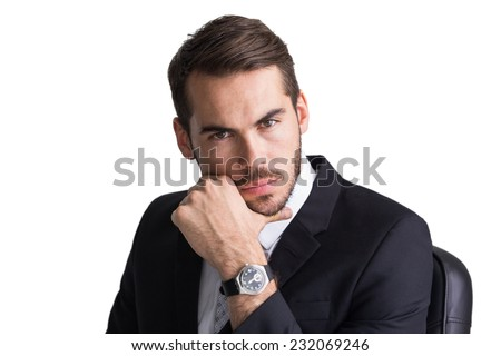 Cheerful businessman posing with hand on chin on white background - stock photo