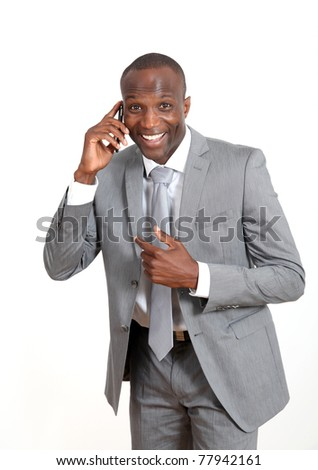 Cheerful businessman talking on mobile phone