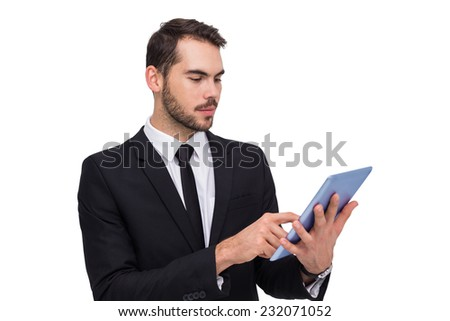 Cheerful businessman touching digital tablet on white background - stock photo