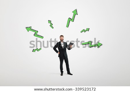 cheerful businessman with black folder and green arrows flying away from himover light grey background