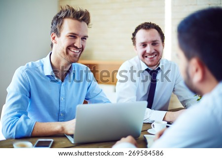 Cheerful businessmen listening to candidate for vacancy - stock photo