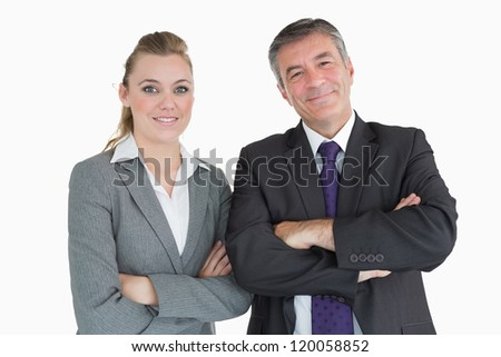 Cheerful businesspeople having arms crossed