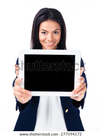 Cheerful businesswoman showing tablet computer screen over white background. Looking at camera - stock photo