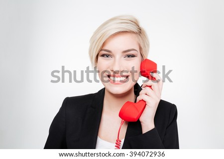 Cheerful businesswoman talking on the phone tube isolated on a white background - stock photo