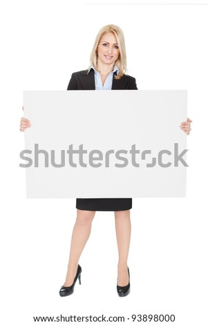 Cheerful businesswomen presenting empty board. Isolated on white - stock photo