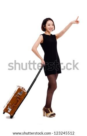 Cheerful businesswomen with travel bag - stock photo