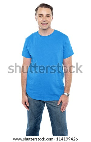 Cheerful calm male model posing in trendy casuals against white background