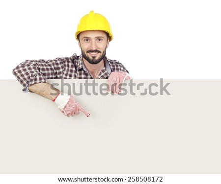 Cheerful carpenter showing a blank board, white background - stock photo