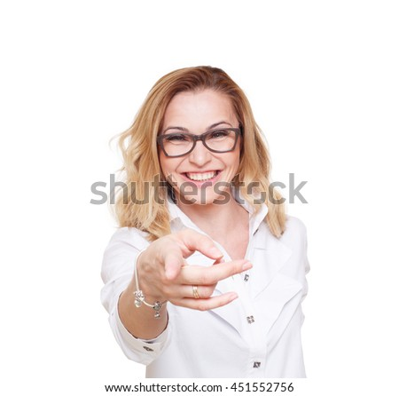 Cheerful caucasian lady in eyeglasses laugh and point finger at camera isolated at white background. Blond middle-aged attractive woman in glasses, happy and positive - stock photo