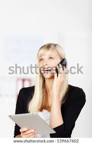 Cheerful Caucasian woman calling and holding her tablet