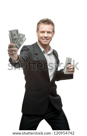 cheerful caucasian young businessman in gray suit holding money isolated on white background - stock photo