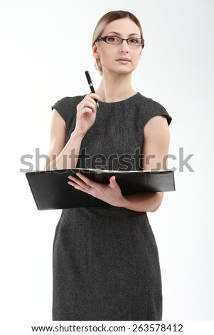 cheerful caucasian young businesswoman holding book isolated on  - stock photo