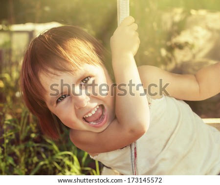 Cheerful child in a warm summer day. - stock photo
