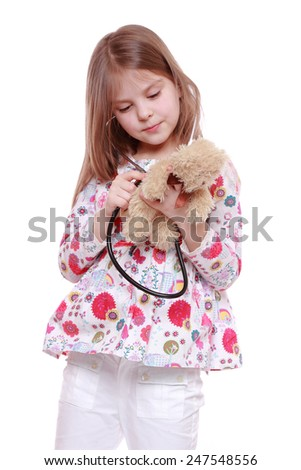 cheerful child playing with toy  - stock photo
