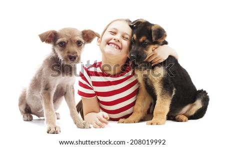 cheerful child tenderly hugging a puppy - stock photo