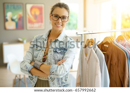 Cheerful Clothing Salesperson Standing Shop Stock Photo (Royalty ...