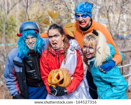 cheerful company of evil in nature halloween - stock photo
