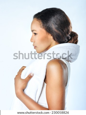 Cheerful confident young black woman with towel after gym portrait. Profile. Sexy fit woman posing with towel - stock photo