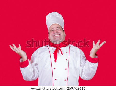 cheerful cook on a red background - stock photo
